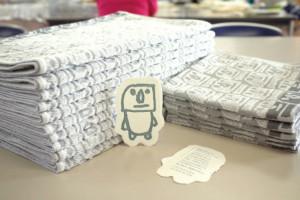 タオルの製造はあえてメーカーに依頼。品質保証と施設の負担減を目指した
